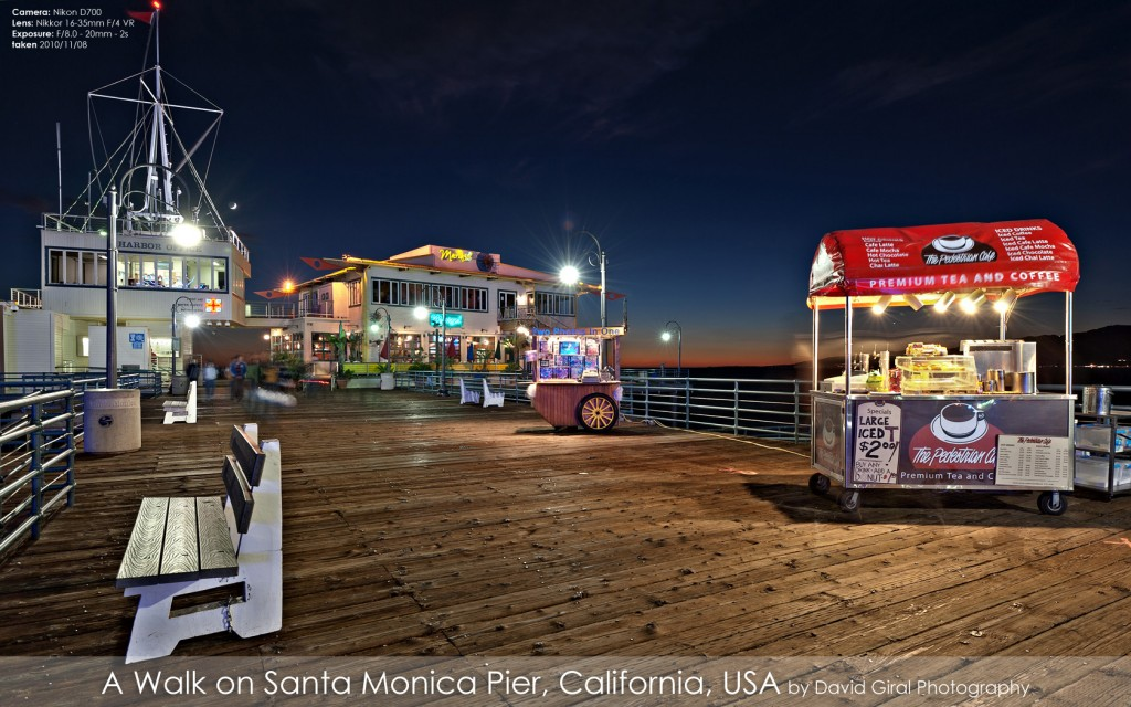Harbour Office, Mariasol Restaurant and stores on Santa Monica Pier at the blue hour, California by David Giral