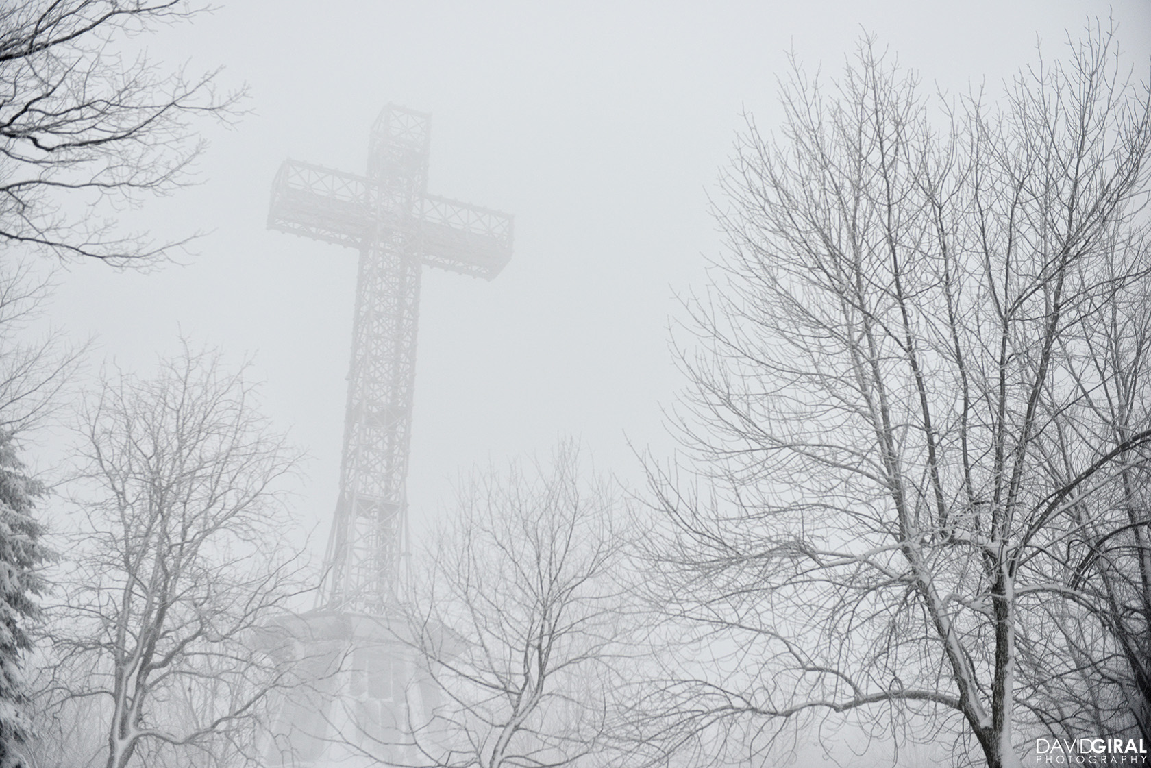 Mont Royal Cross during a misty snowy morning at Mont Royal Park in Montreal