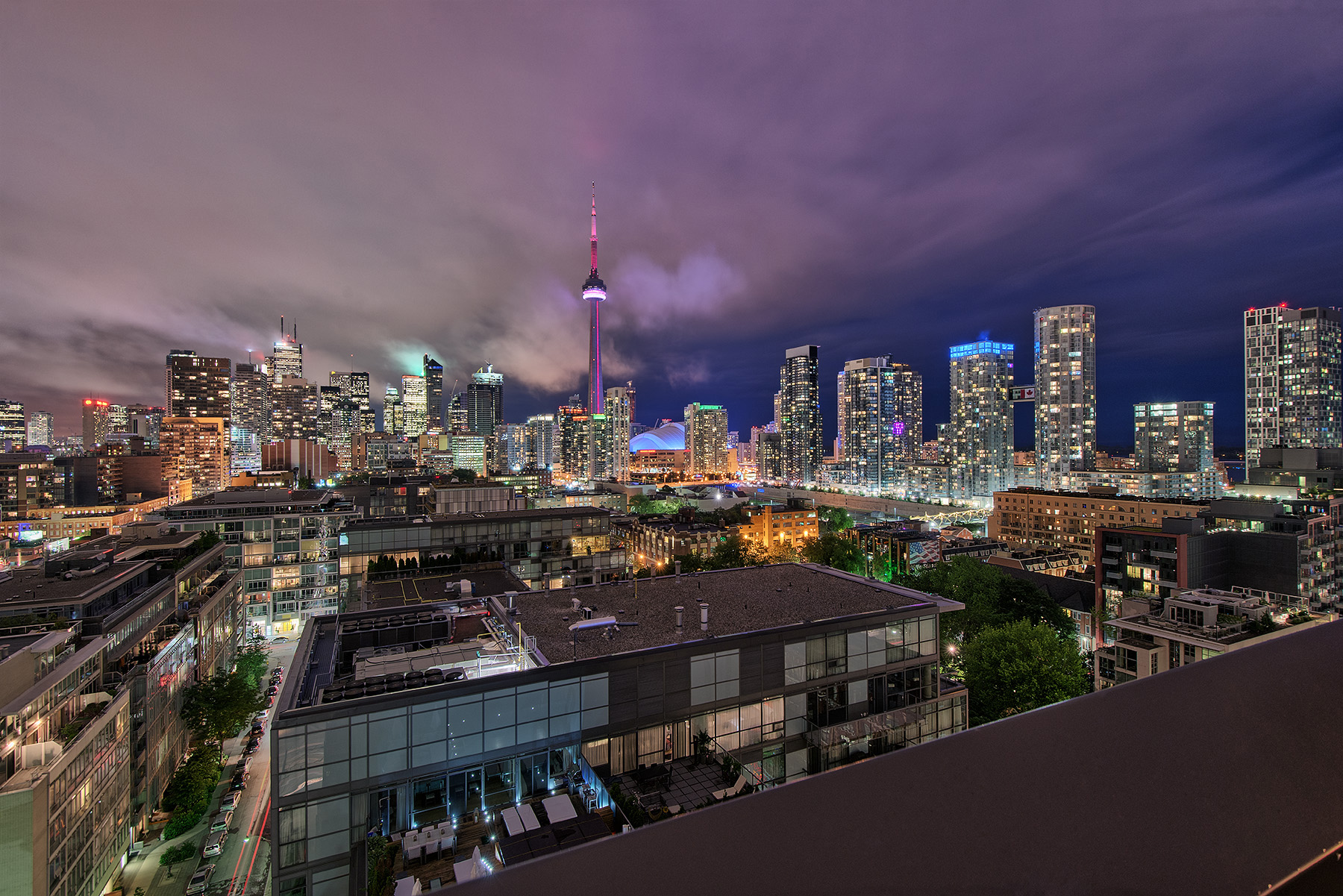 Toronto Skyline at dusk and the blue hour viewed from Thompson Hotel Rooftop Bar & pool